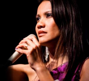Charmaine Clamor singing on the mic
